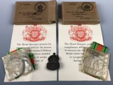 Two Second World War Defense Medals in original cartons addressed to related recipients, together