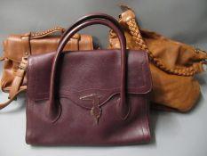 Three various ladies designer style handbags