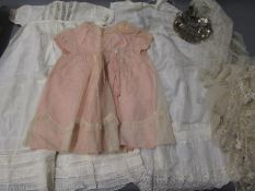 Box containing a quantity of various early 20th Century childs clothes and a ladies white wedding