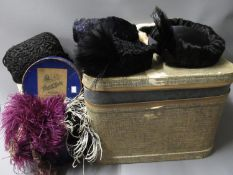 Small rectangular trunk containing a collection of various fur and feather hats, two ostrich feather