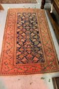 Hamadan rug with all-over Herati design on a blue ground with rose ground borders, 6ft 6ins x 3ft