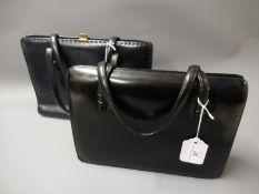 Two vintage black leather handbags