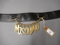 Moschino ladies leather belt with gilt metal hanging logo on chain