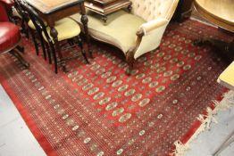 Pakistan Bokara pattern carpet on red ground