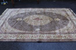 20th Century machine woven rug having all-over floral design with multiple borders on a gold ground,