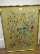 Crewel work picture of birds and flowers in a simulated bamboo frame, 27.5ins x 20.5ins together