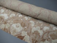 One roll of pink fabric, two boxes containing a large quantity of upholstery / curtain / tapestry