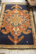 Kurdish rug with lobed medallion design on a royal blue ground with three guard stripes, 6ft x 3ft