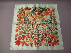 Hermes silk kerchief, autumn leaves on pale green ground, 42cms square, in a Hermes box
