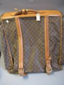 Louis Vuitton, folding suit carrier with leather straps and leather handles (wear from use)