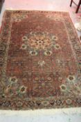 Tabriz rug having central medallion with all-over floral design on a wine ground with multiple