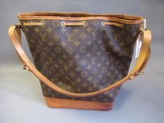 Louis Vuitton, ladies bucket bag with leather strap and leather tie top