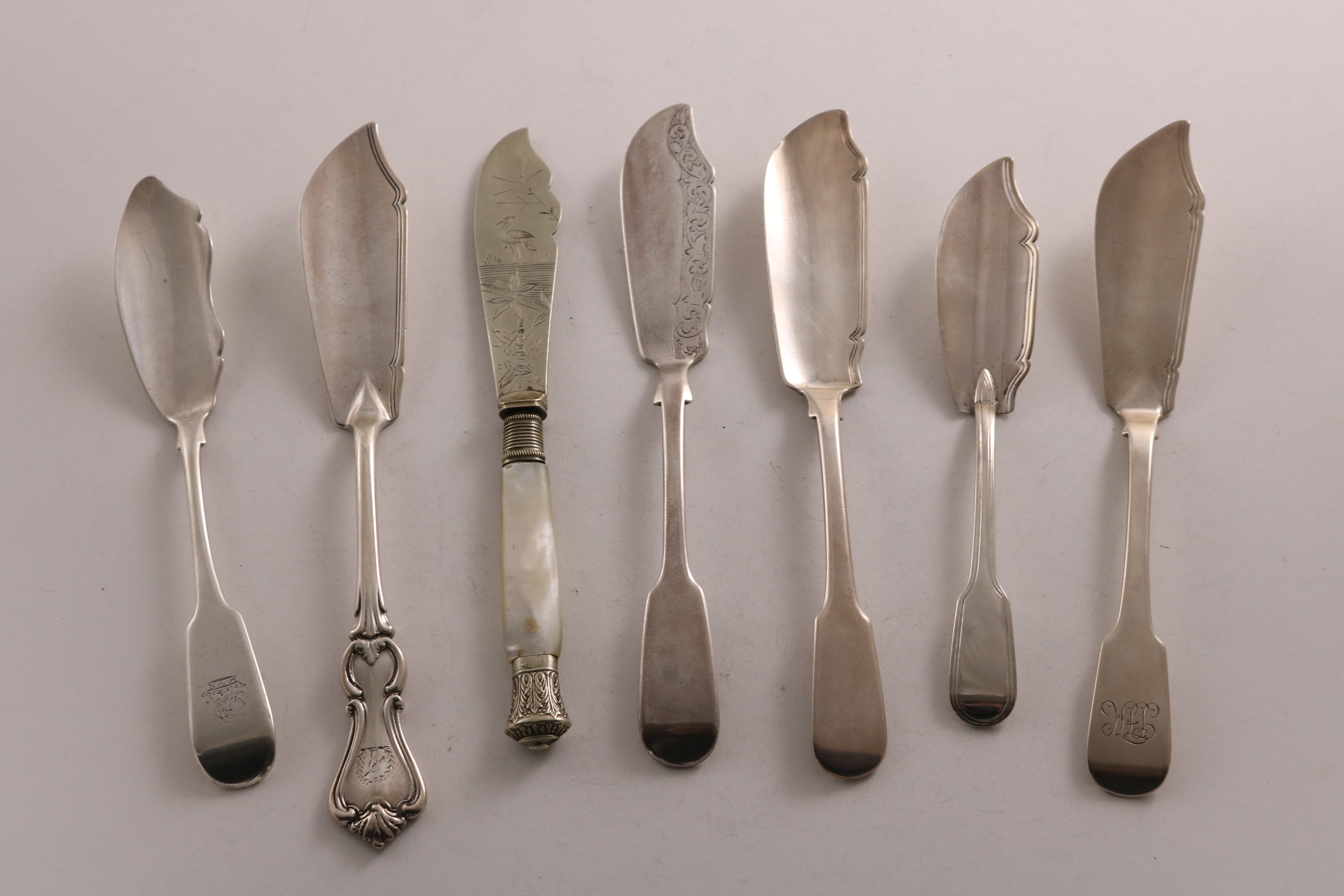 Lot 59 - BUTTER KNIVES:- A George III silver Fiddle pattern example by Paul Storr, London 1816, a Canadian