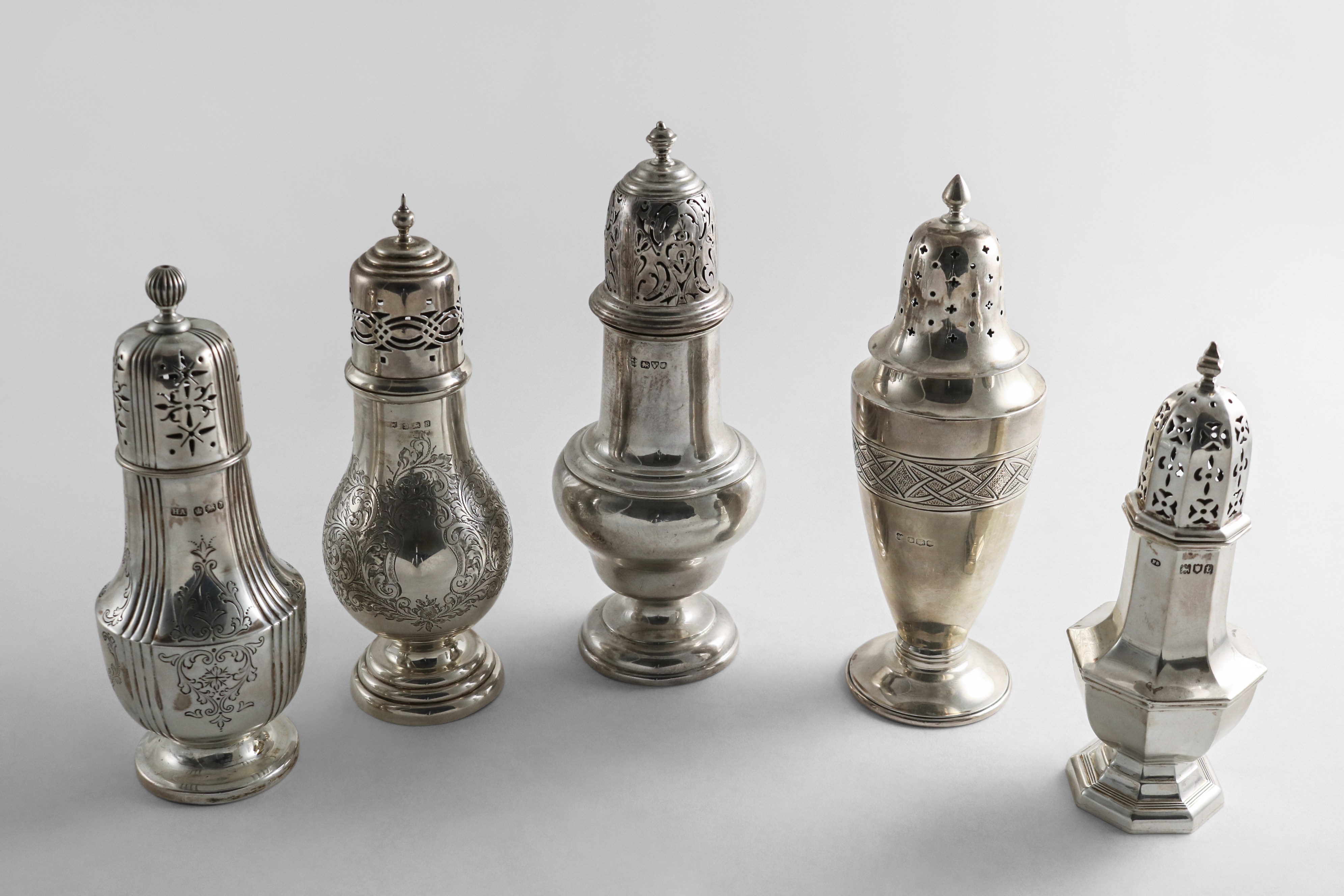Lot 12 - A SMALL COLLECTION OF FIVE VARIOUS SILVER SUGAR CASTERS mixed designs, makers and dates,