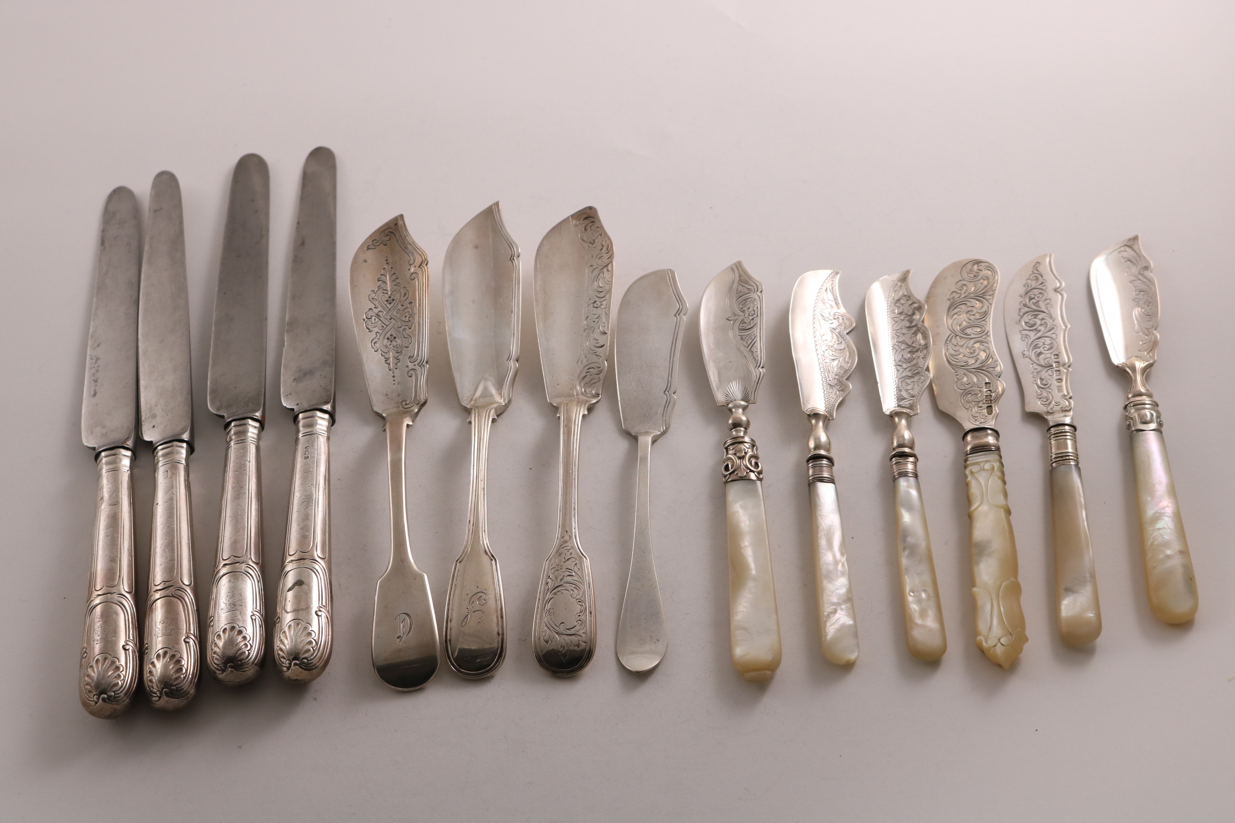 Lot 57 - A SMALL COLLECTION OF SILVER BUTTER KNIVES mixed dates & makers, Victorian-Edwardian (including