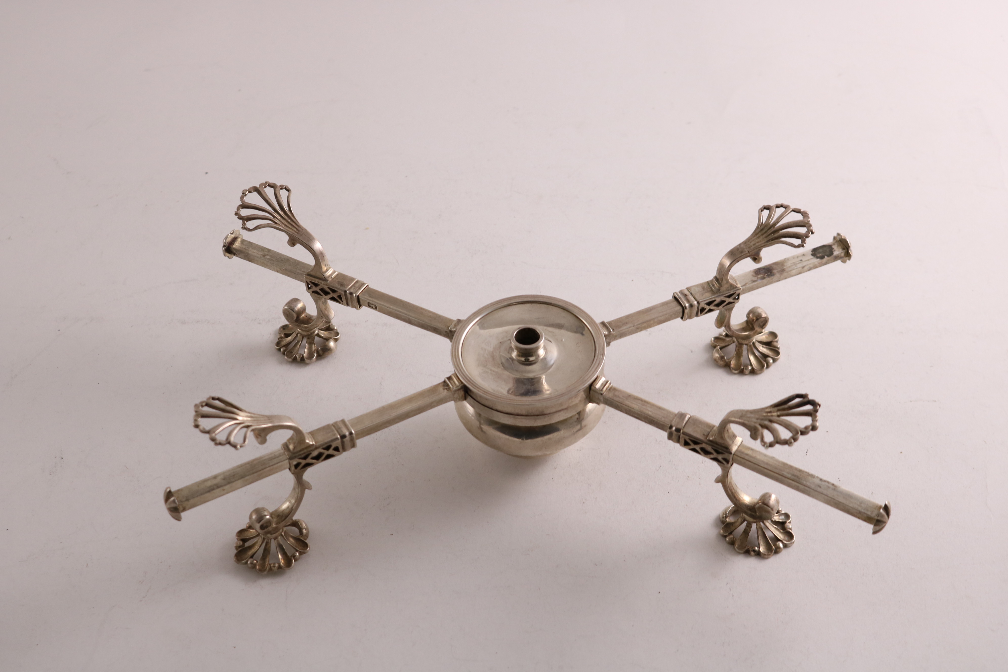 Lot 2 - A GEORGE III ADJUSTABLE DISH CROSS with pierced feet and supports and a central burner, probably
