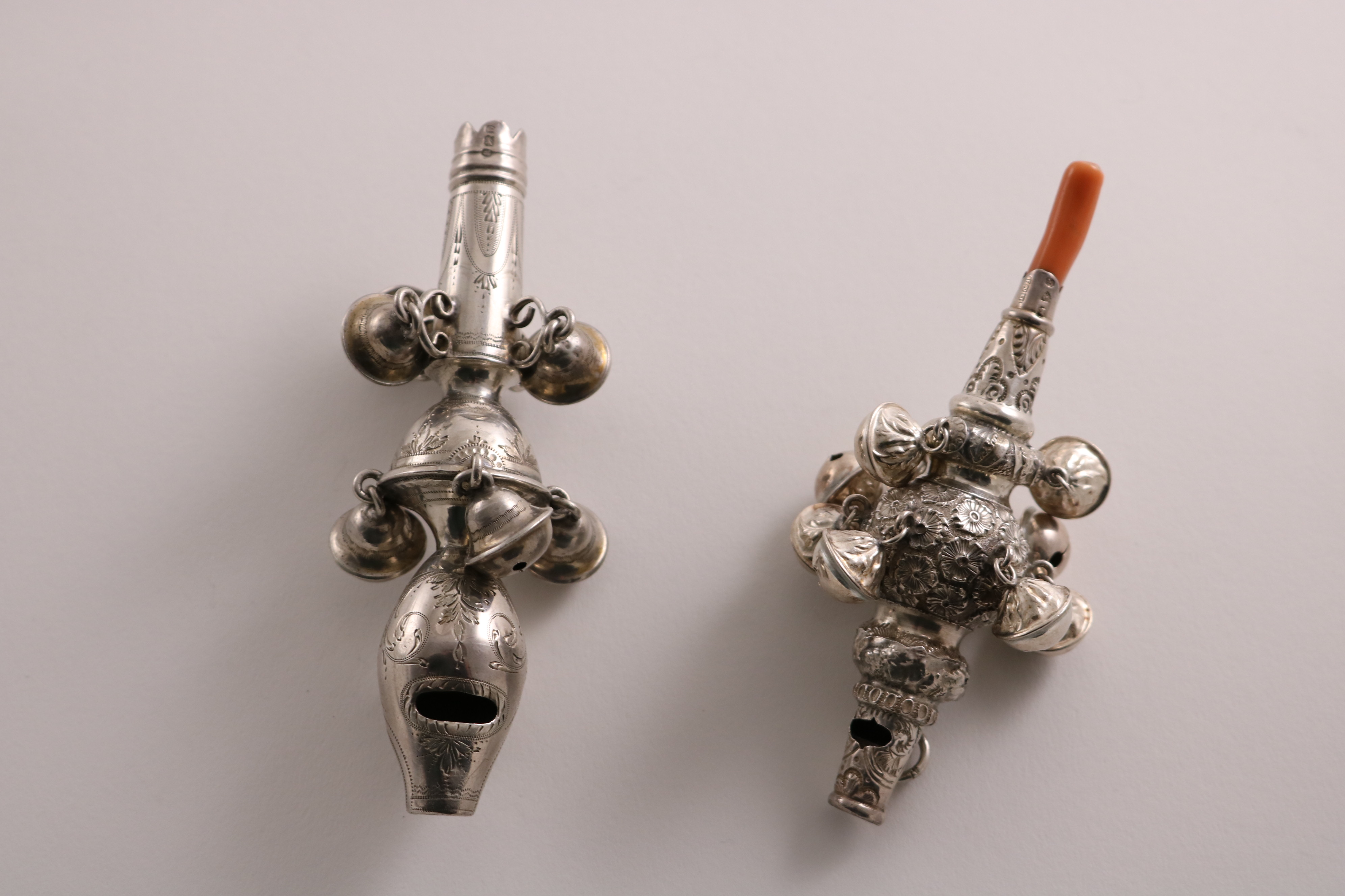 Lot 30 - A GEORGE III ENGRAVED SILVER RATTLE with a whistle terminal and seven bells dependant (lacking one
