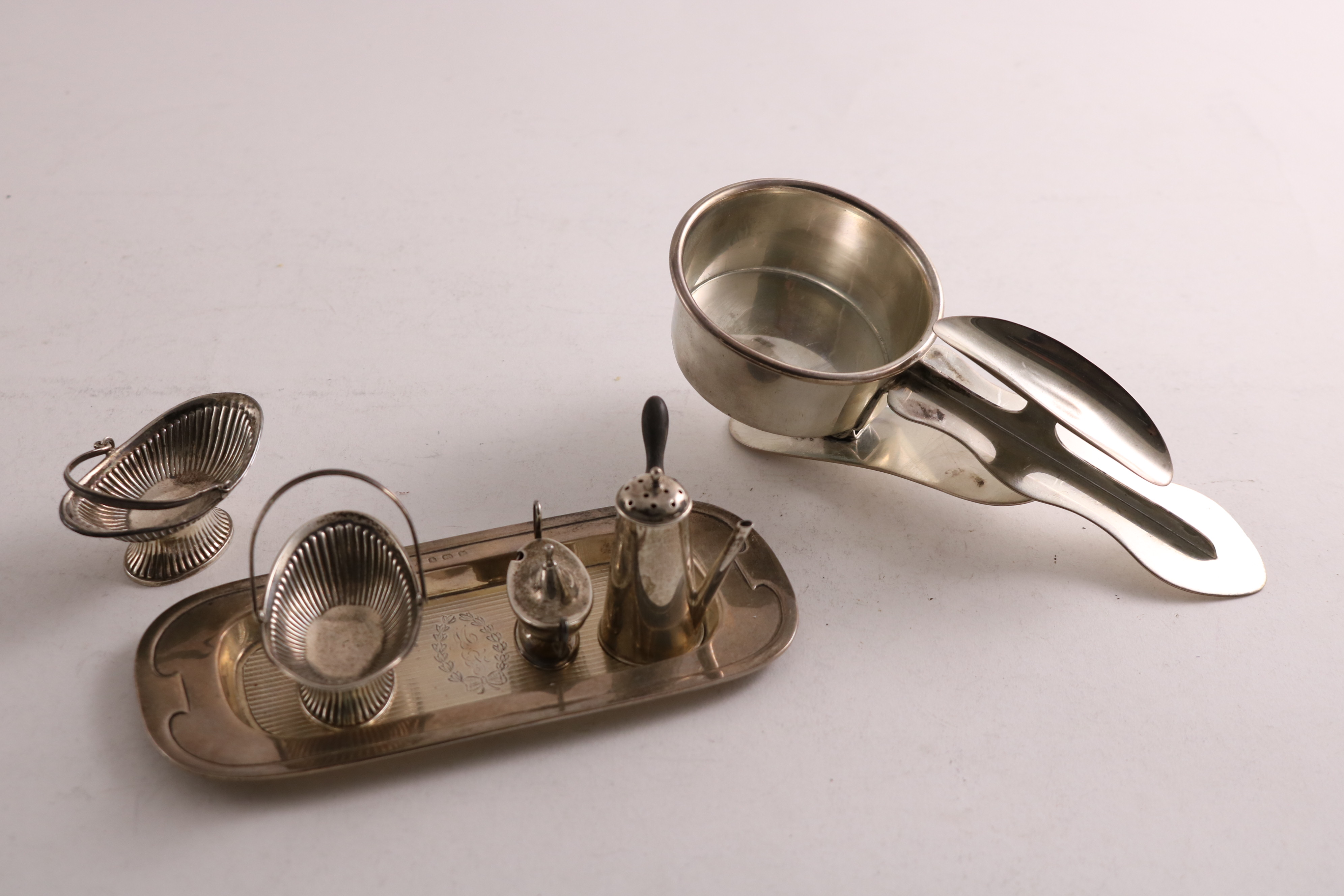Lot 44 - SILVER MINIATURES OR TOYS:- an Edwardian swing handled basket with part-fluting, by Levi &