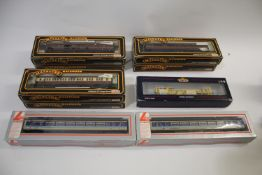 RAILWAY ROLLING STOCK & LAYOUT ACCESSORIES a mixed lot including 6 boxed Mainline coaches, a boxed