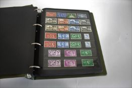 GREAT BRITAIN STAMP ALBUMS including an album with QE 11 mint and used examples (including £1