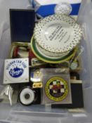 A Box of Eventing Ephemera, to include appearance plaques, trade gifts, paddock passes, badges,