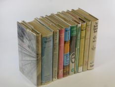 Motor Racing. A selection of ten octavo hardback volumes, all with their dust jackets (some with a