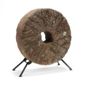 A Small Antique Millstone with Stand