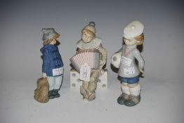 TWO LLADRO FIGURINES - BOY DRESSED AS A CLOWN PLAYING ACCORDION AND BOY CARRYING FOOTBALL,