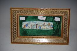 A 20TH CENTURY PERSIAN SCHOOL WATERCOLOUR ON IVORY OF EIGHT FIGURES AT AN OASIS