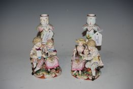 PAIR OF CONTNENTAL MEISSEN STYLE FIGURAL CANDLESTICKS IN THE FORM OF ROMANTIC COUPLES