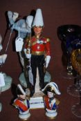 PORCELAIN FIGURE OF AN OFFICER, TITLED 'GENTLEMAN AT ARMS', TOGETHER WITH TWO CERAMIC GERMAN BUST