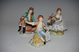 THREE DRESDEN PORCELAIN FIGURINES - YOUNG BOY WITH SCYTHE, YOUNG GIRL WITH GOAT AND YOUNG BOY WITH
