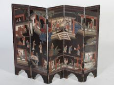 A late 19th/early 20th century Chinese lacquered five fold screen of small size, with carved