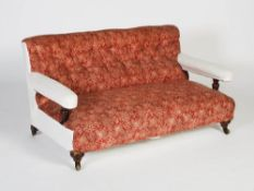 A late 19th century mahogany sofa, Howard & Sons, London, the button down upholstered back and stuff