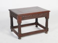 A late 19th century oak occasional table, the rectangular top above a foliate carved frieze,