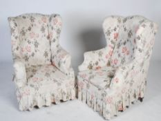 A pair of late 19th century mahogany wing armchairs, the upholstered back, arms and seats raised