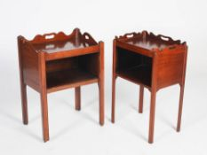 A matched pair of adapted George III mahogany tray top commodes, each with a rectangular top and