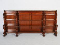 A late 19th century mahogany and ebony lined Egyptian Revival open bookcase, the rectangular top