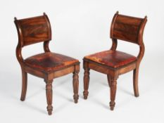 A pair of William IV mahogany and brass inlaid hall chairs, the convex and concave uprights