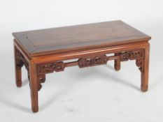 A Chinese dark wood Kang table, late 19th/early 20th century, the rectangular panelled top above a