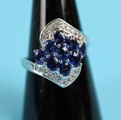 Unusual white gold sapphire & diamond ring