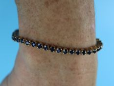 Gold sapphire set bracelet with valuation certificate