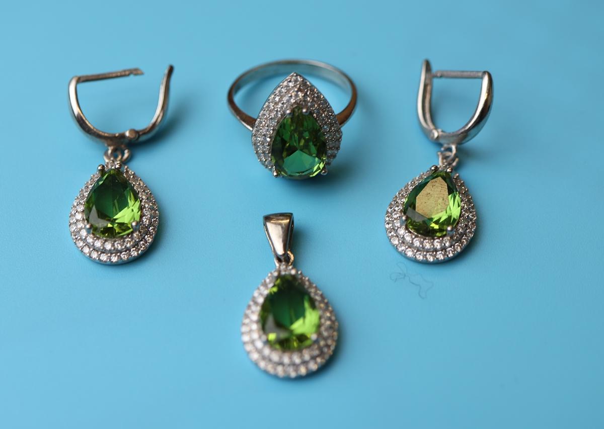 Silver topaz set earrings, pendant & ring