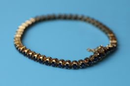 Gold sapphire tennis bracelet with valuation certificate