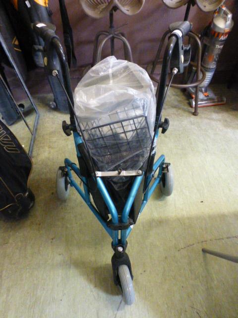 Lot 182 - A blue tubular three wheeled walking aid