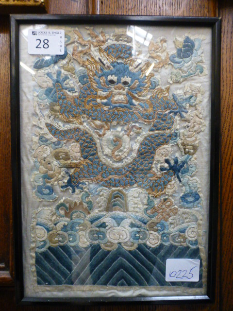 Lot 28 - A framed and glazed Chinese needlework o