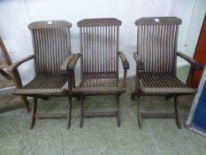 A set of three teak folding garden chair