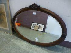 An early 20th century oak framed oval be
