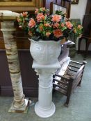 A white ceramic jardiniere stand with pl