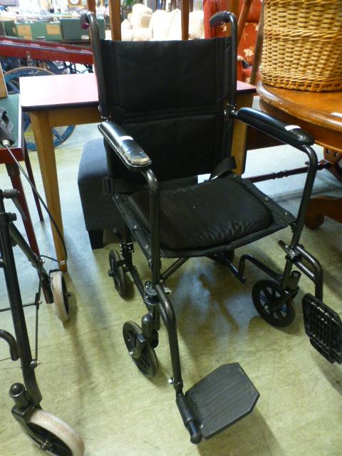 A black tubular wheel chair